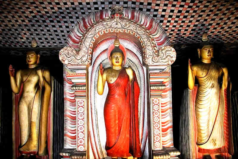 Standing Buddha at Dambulla cave temple,Visiting Sri Lanka Buddhist temples, Sri Lanka temple dress code, temple of the tooth dress code